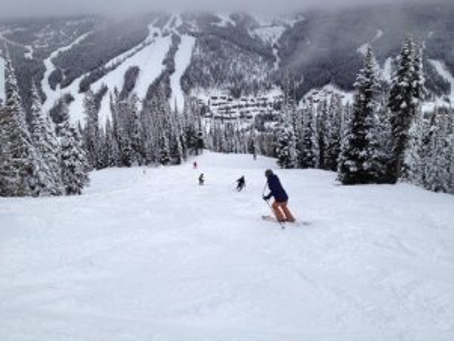Skiing down Mt Morrisey heading towards Sun Peaks village