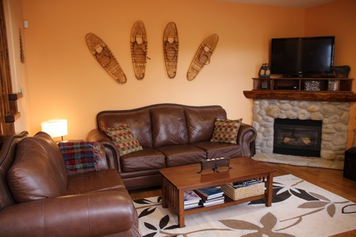 Spacious Trappers Landing Sun Peaks family room with River Rock fireplace at BestSunPeaks.com