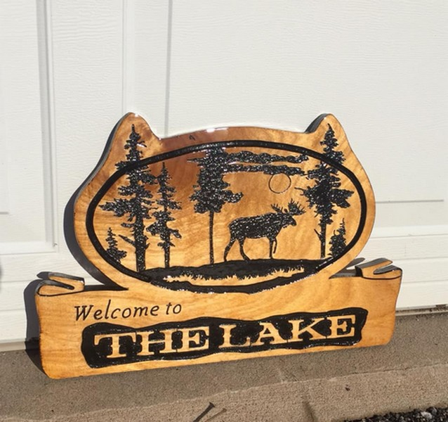Custom carved wood cabin signs