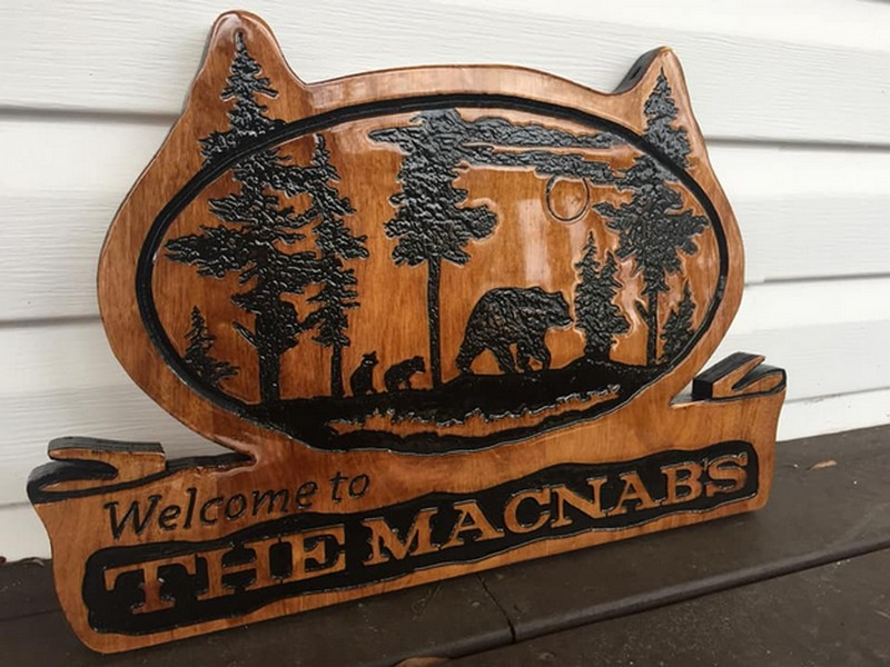 Custom carved wood family signs