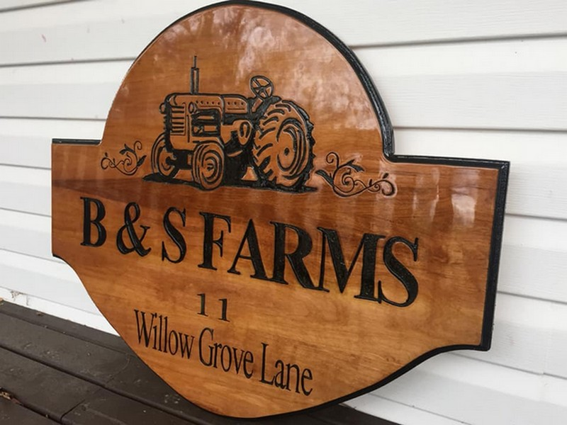 Custom carved wood business signs