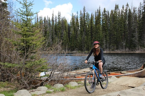 Nancy at McGillivray Lake bike trail - photo by BestSunPeaks.com