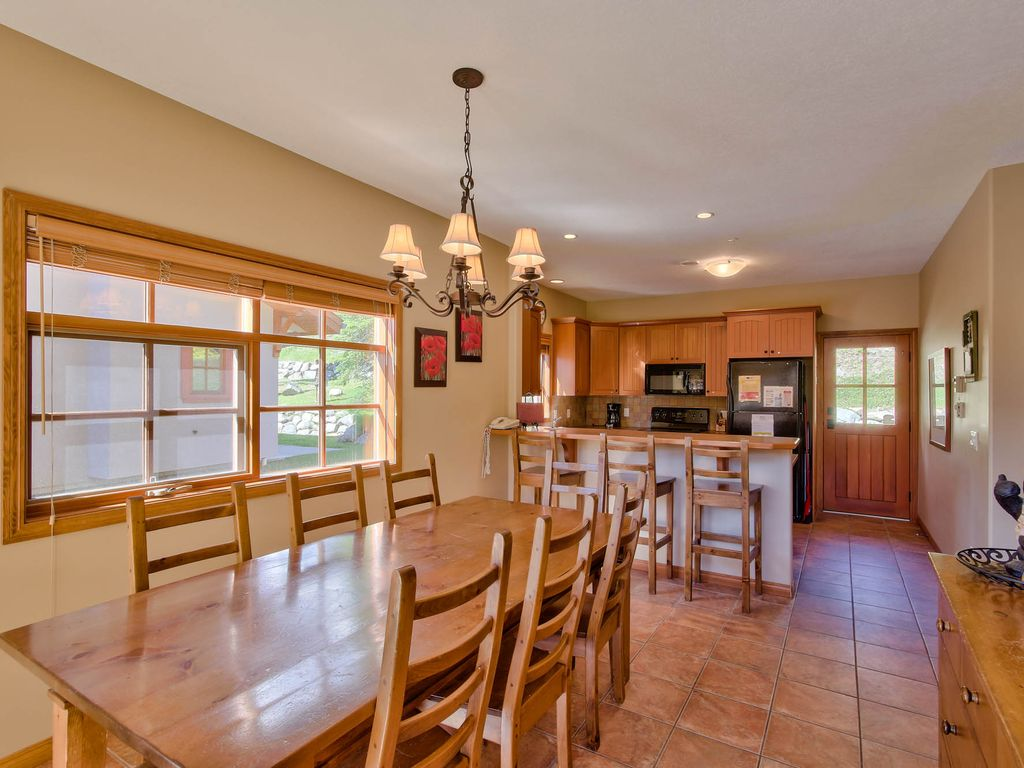 Trail's Edge 15 townhouse with plenty of windows and a sliding door to the spacious deck