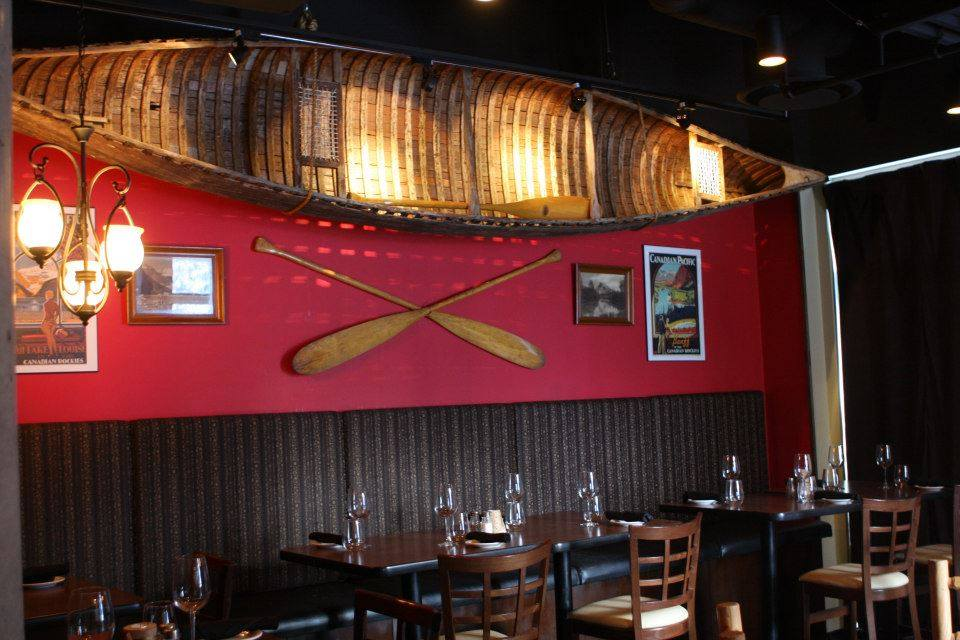 canoe on wall of Voyageur Bistro in Sun Peaks