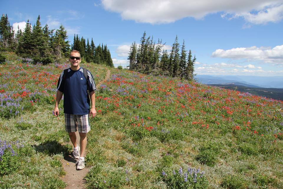 Wildflower blossoms and panoramic view at Sun Peaks Resort with beautiful summer hikes - photo by BestSunPeaks.com